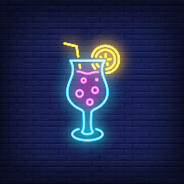 Tropical cocktail neon sign. Fizzy alcohol\ drink with straw on dark brick wall background