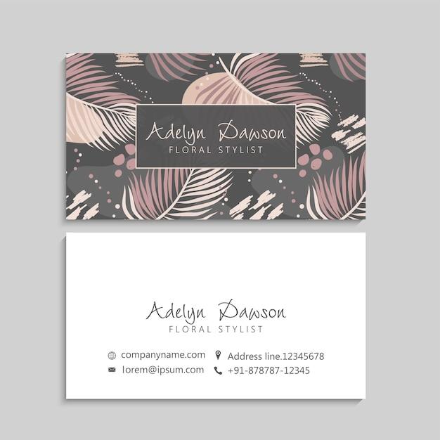 Шаблон визитки с тропическими листьями Бесплатные векторы