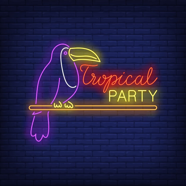 Tropical party neon text with exotic bird Free Vector