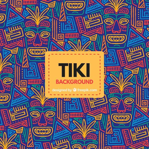 Тропический фон с племенными масками Бесплатные векторы