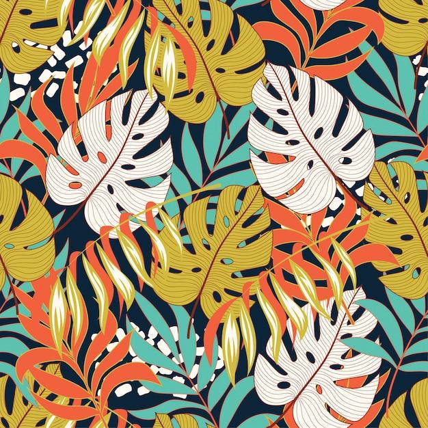 Тропический узор с листьями и растениями Premium векторы