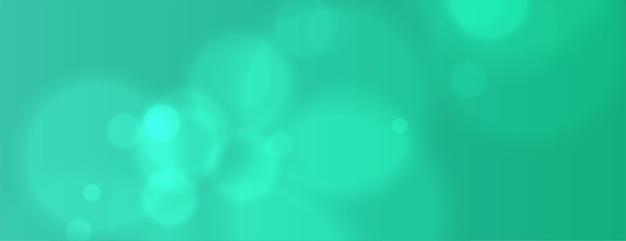 Бирюзовый цвет боке баннер с эффектом размытия Бесплатные векторы