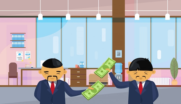 Two asian business men holding dollar banknotes standing Premium Vector