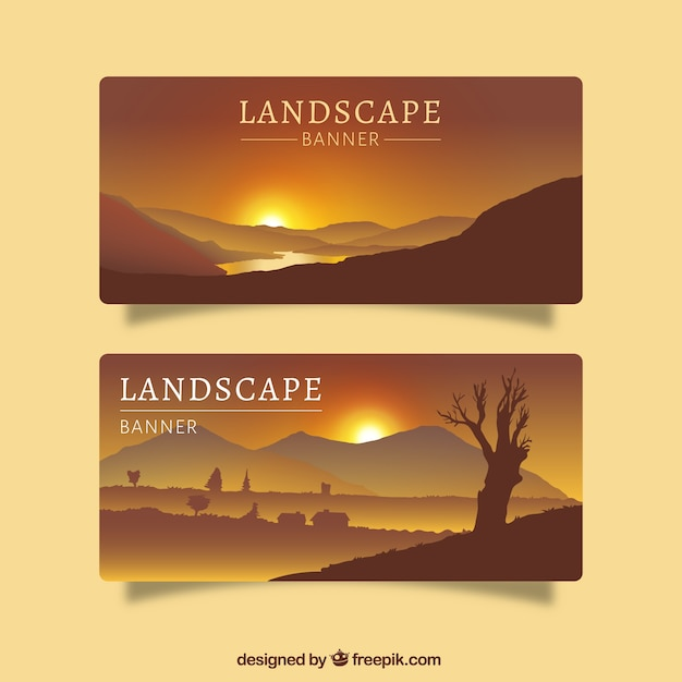 Two banners with desert landscapes