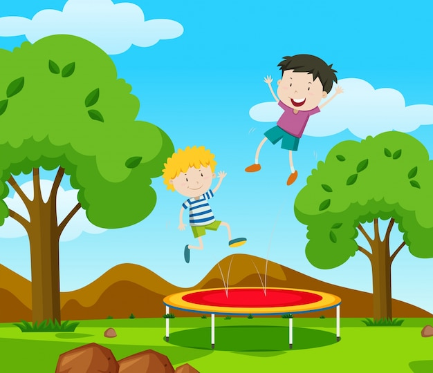 Two boys bouncing on trampoline in the park Free Vector