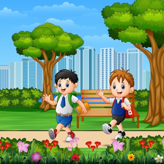 Two boys go to school through the park road Premium Vector