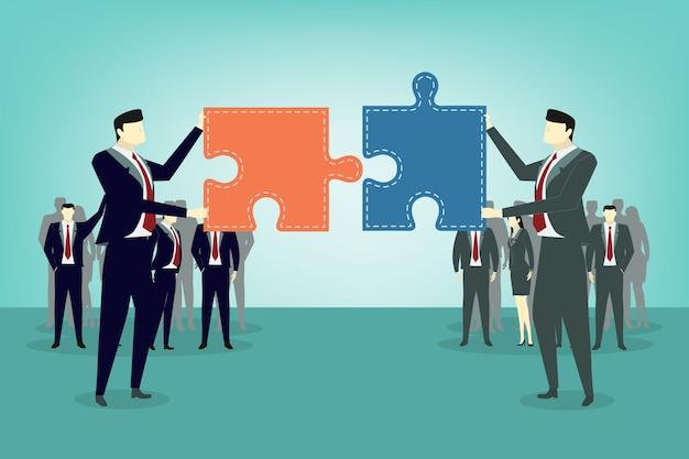 ジグソーパズルの部分を保持している2人のビジネスマン Premiumベクター