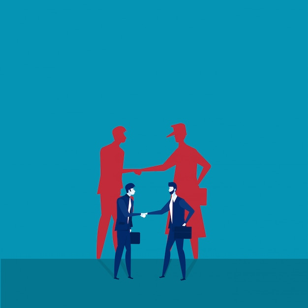 Two businessmen shaking hands with shadow Premium Vector