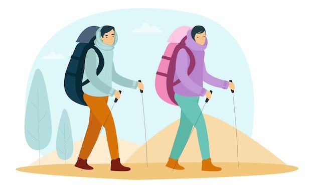 山に登るために2人の登山者が歩いている Premiumベクター