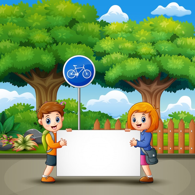 Two cute kids are holding a banner in the city park Premium Vector