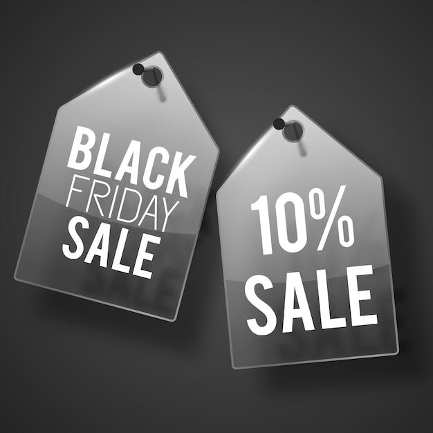 검은 금요일 판매 설명과 함께 벽에 박힌 두 개의 짙은 회색 판매 태그 세트 무료 벡터