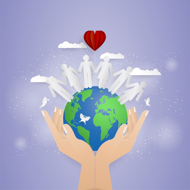 Two hand holding world and people on the world Premium Vector