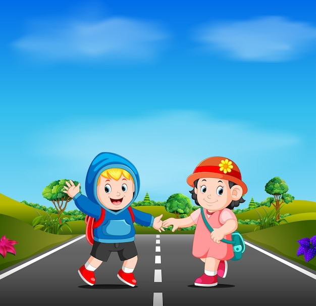 Two kids go to school on the road Premium Vector