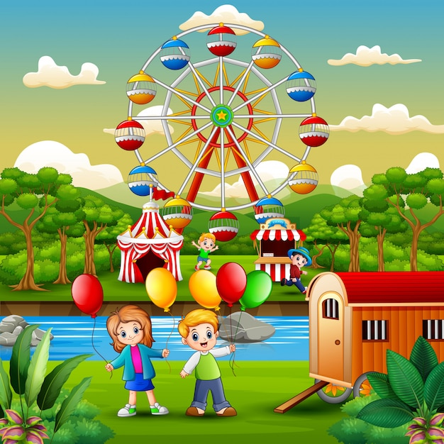 Two kids holding a balloons and having fun at amusement park Premium Vector