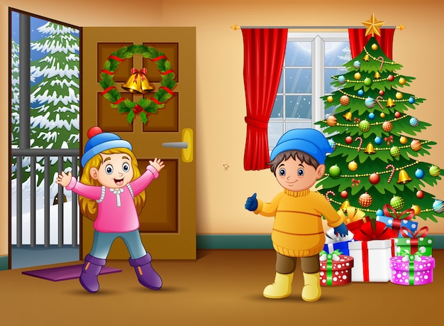 Two kids in the living room with christmas tree decorating Premium Vector