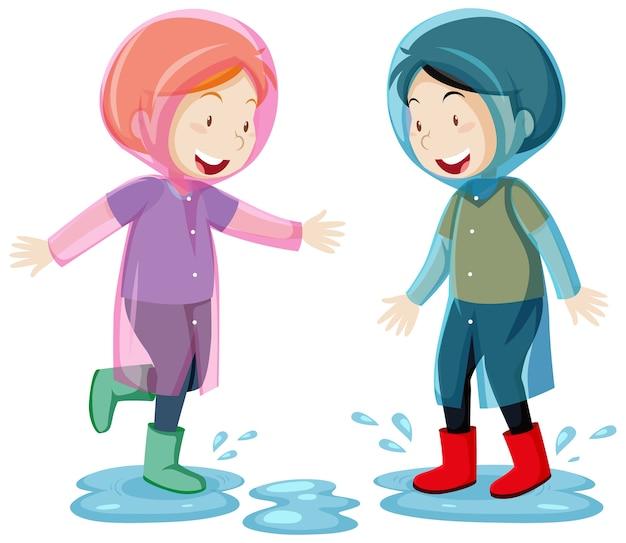 白い背景で隔離の水たまり漫画スタイルでジャンプするレインコートを着た2人の子供 Premiumベクター