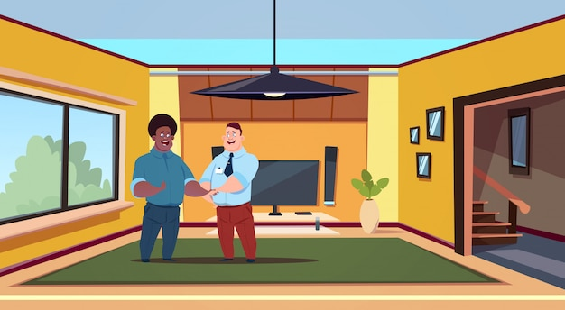 Two man agent and new owner in modern living room shaking hands buying house concept Premium Vector