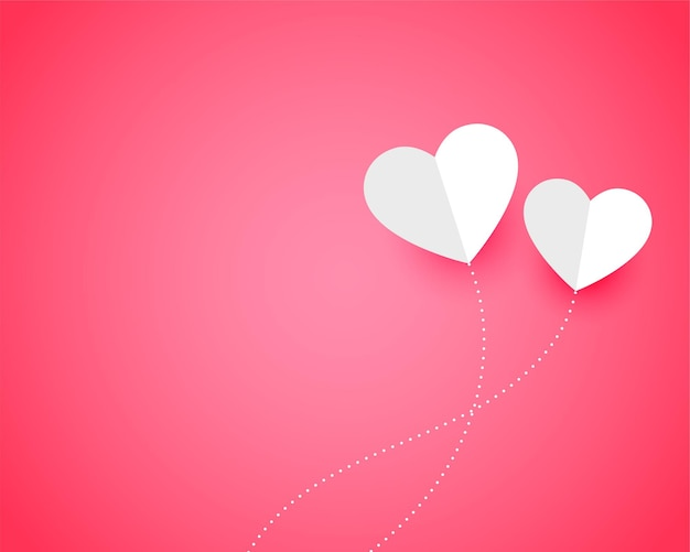 Two paper hearts on pink with text space Free Vector