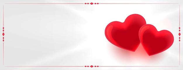 Два красных любовных сердца с пространством для текста Бесплатные векторы