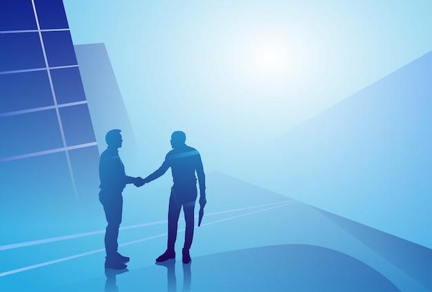 Two silhouette businessman hand shake, business man handshake agreement concept Premium Vector