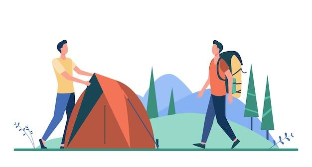 초원에 텐트를 던지는 두 관광객. 무료 벡터