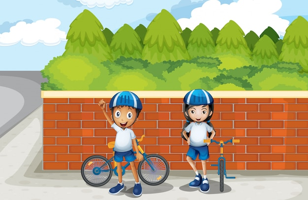 Two young bikers at the street Free Vector