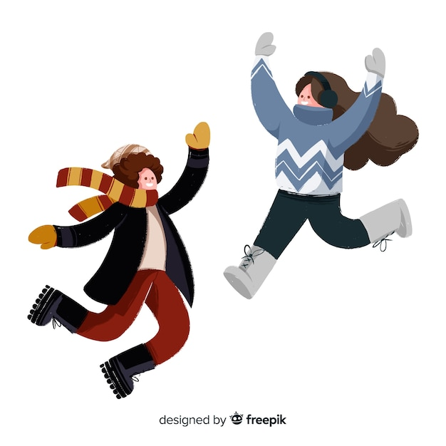 Two young people wearing winter clothes jumping Free Vector