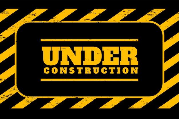 黄色と黒のストライプの建設の背景の下で 無料ベクター