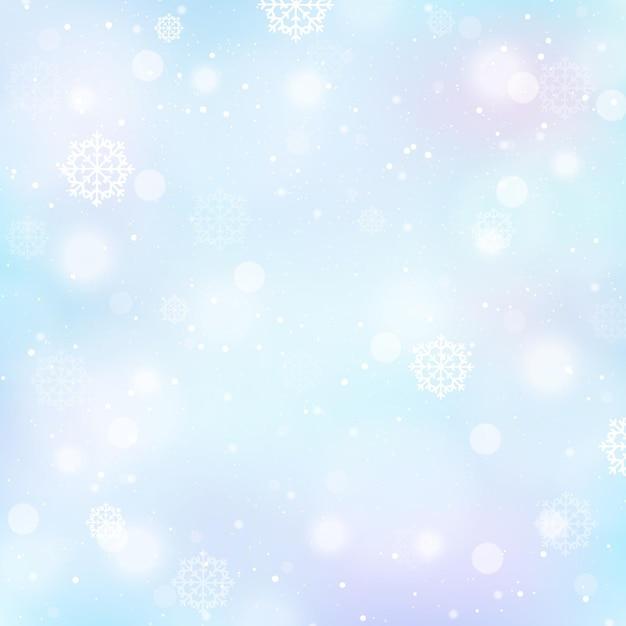 Sfondo invernale sfocato con fiocchi di neve Vettore gratuito