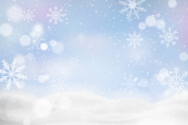 Unfocused winter landscape with snowflakes Free Vector