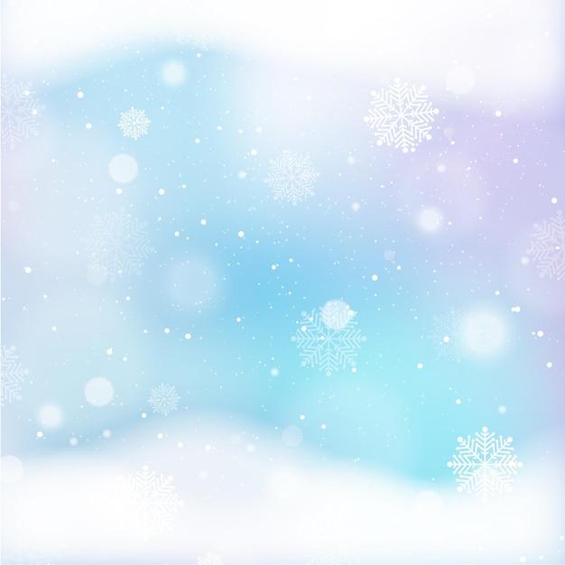 Несфокусированные зимние обои со снежинками Premium векторы