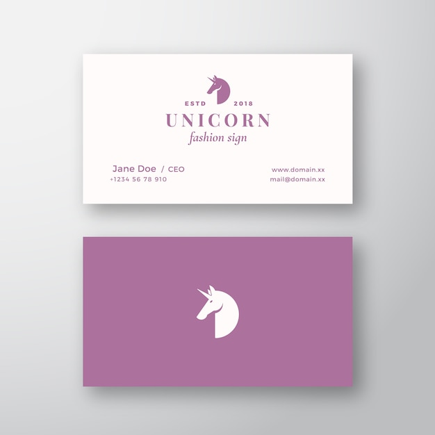 Unicorn abstract feminine  sign or logo and business card template. premium stationary realistic mock up. modern typography and soft shadows. Premium Vector