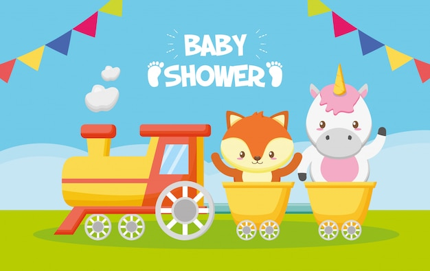 Unicorn and fox in train for baby shower card Free Vector