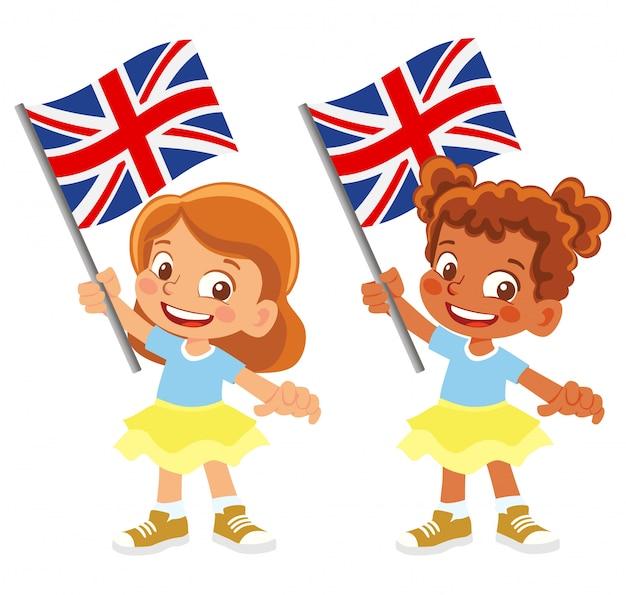 Флаг соединенного королевства в руке Premium векторы