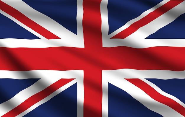 イギリスの旗、現実的な手を振っているユニオンジャック Premiumベクター