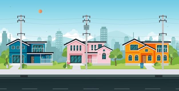 通りに電柱とケーブルがある都会の家。 Premiumベクター