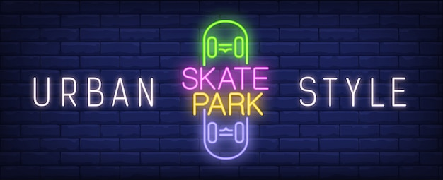 Urban style skate park neon sign. Colorful\ inscription on skateboard on dark brick wall.