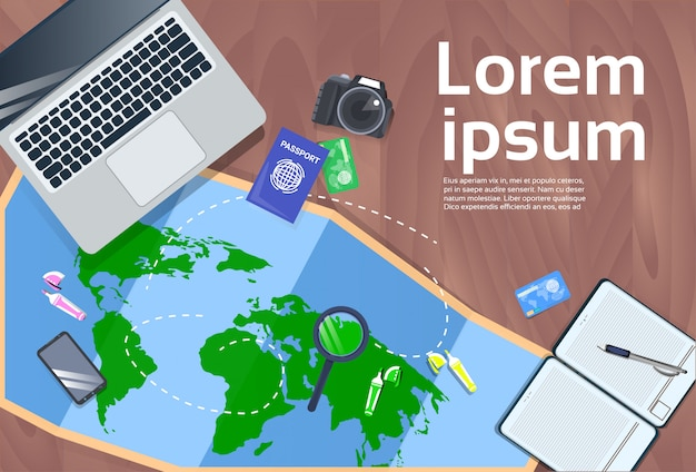 Vacation planning and travel concept desktop with laptop, map, photo camera and passport top view Premium Vector
