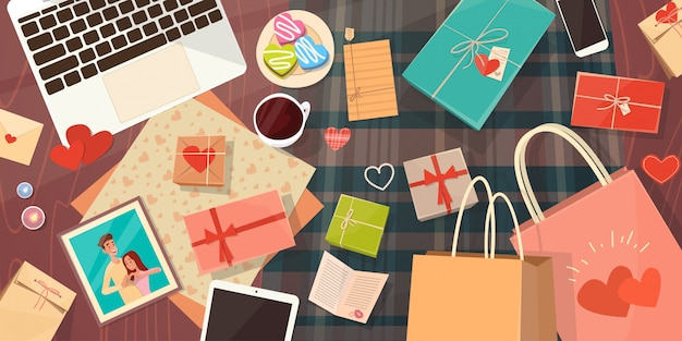 Valentine day gift card holiday decorated workspace desk copy space top angle view Premium Vector
