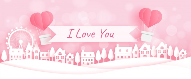 Valentine's day banner with hot air balloons in paper cut Premium Vector