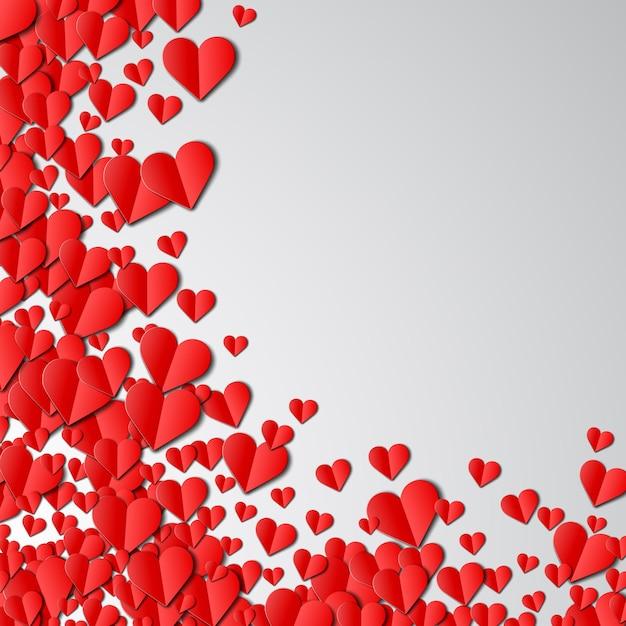 Открытка на день святого валентина с разбросанными сердечками из вырезанной бумаги Premium векторы