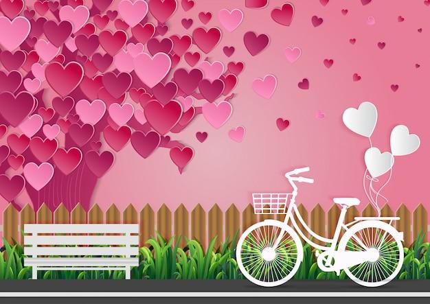 バレンタインデーの愛の概念通りに自転車があり、風船が結ばれています。ピンクの空の美しい自然。ベクトルイラスト Premiumベクター