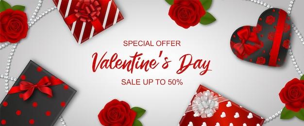 선물 상자와 빨간 장미 발렌타인 판매 배너 프리미엄 벡터