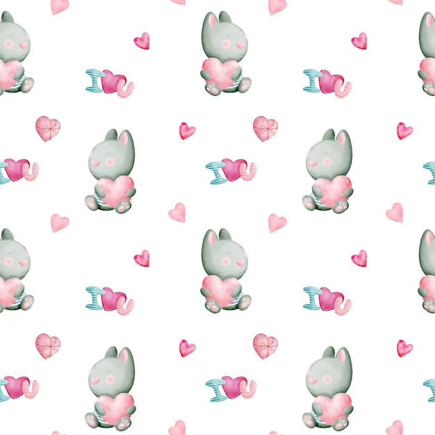 Valentine's day watercolor seamless pattern with rabbits and hearts Premium Vector
