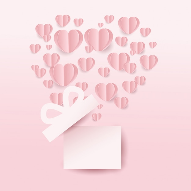 Valentine's gift box and hearts flying, heart shape on pink background. paper cut style. vector illustration Premium Vector