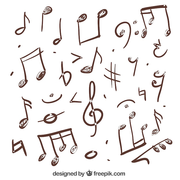 Variety of hand drawn musical notes Free Vector