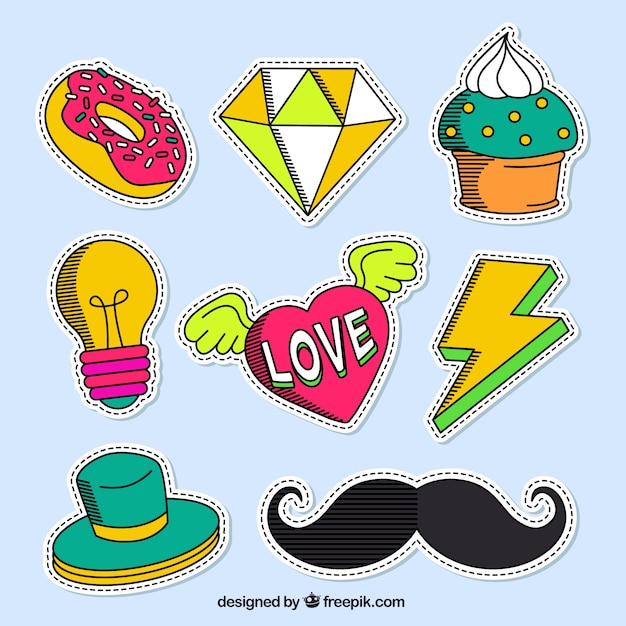 Variety of hand drawn patches in colors Free Vector