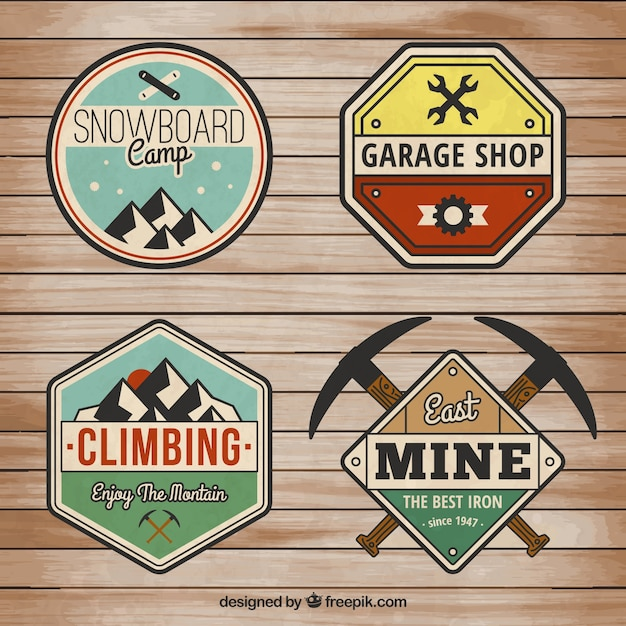 Variety of retro badges Free Vector