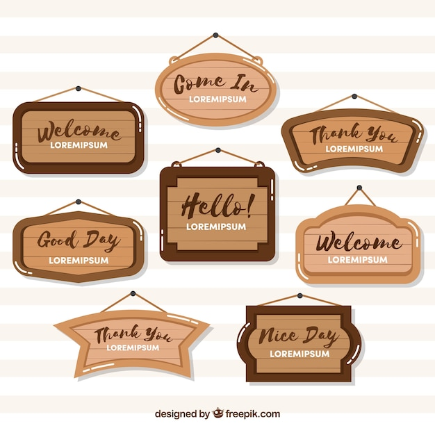 Variety of wooden signs in flat design Free Vector