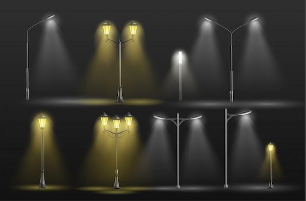 어둠 속에서 빛나는 다양한 도시 가로등 노란색 따뜻하고 차가운 하얀 빛 무료 벡터